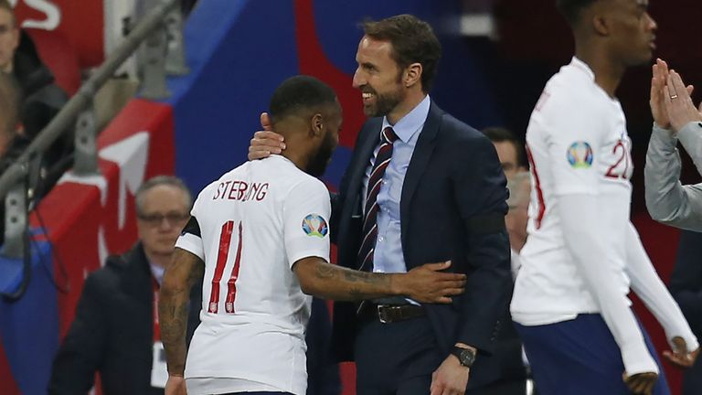 England manager Gareth Southgate (R) congratulates England's midfielder Raheem Sterling after substituting him during the UEFA Euro 2020 Group A qualification football match between England and Czech Replublic at Wembley Stadium in London on March 22, 201