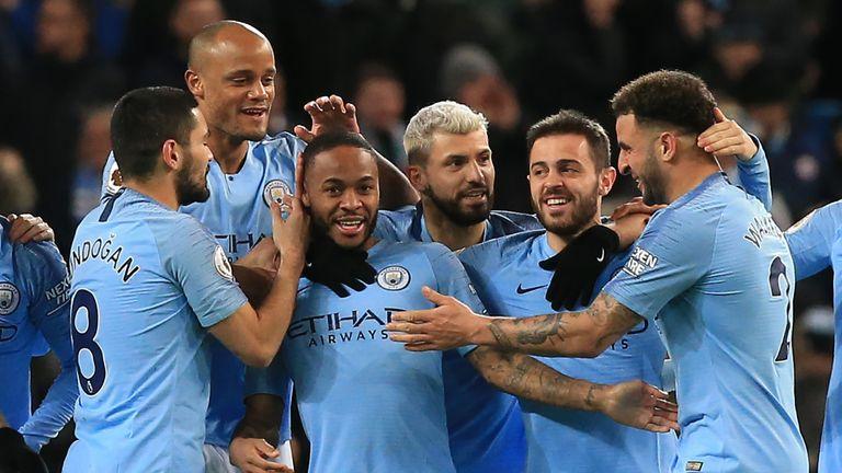 Raheem Sterling celebrates his opener with Man City team-mates