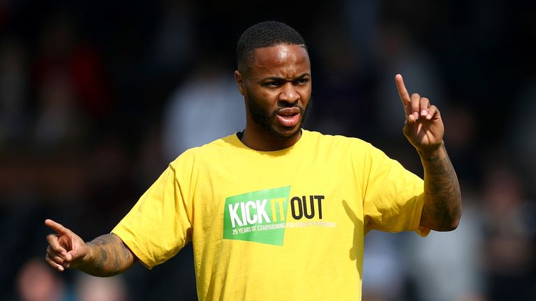 Raheem Sterling warms up for Manchester City wearing a 'Kick It Out' t-shirt