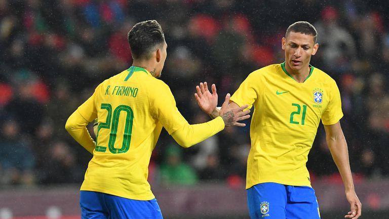 Roberto Firmino celebrates scoring Brazil's equaliser against Czech Republic with team-mate Richarlison