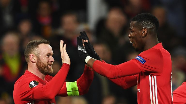 Wayne Rooney of Manchester United celebrates with Paul Pogba as he scores their first goal during the UEFA Europa League Group A match between Manchester United FC and Feyenoord at Old Trafford on November 24, 2016 in Manchester, England.
