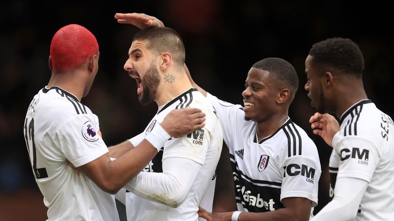 Ryan Babel and Aleksandar Mitrovic celebrate Fulham's equaliser against Liverpool at Craven Cottage