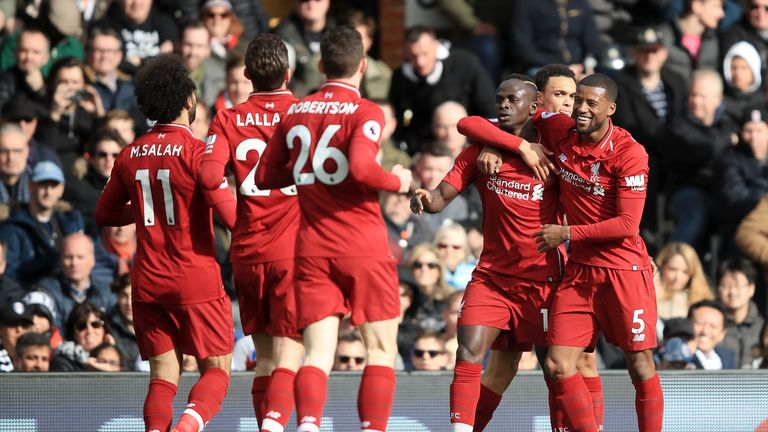 Sadio Mane celebrates with Liverpool team-mates after scoring against Fulham