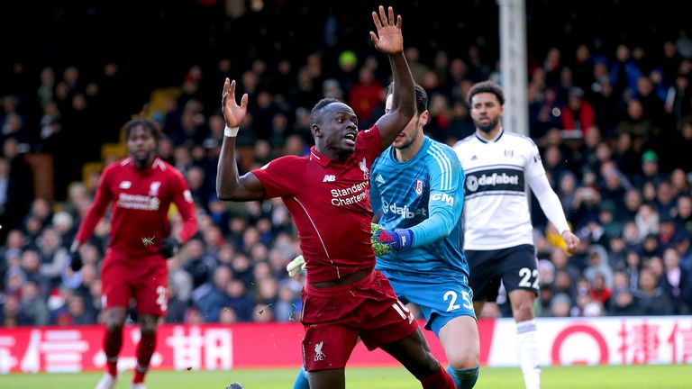 Fulham goalkeeper Sergio Rico (second right) fouls Liverpool's Sadio Mane resulting in a penalty during the Premier League match at Craven Cottage, London.