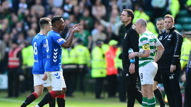 Brown smiles as Morelos makes his way off the pitch in the Old Firm clash