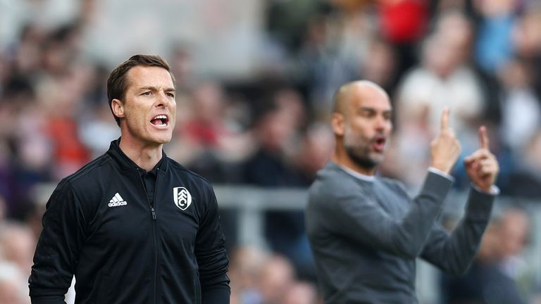 Fulham's caretaker manager Scott Parker gives his team instructions