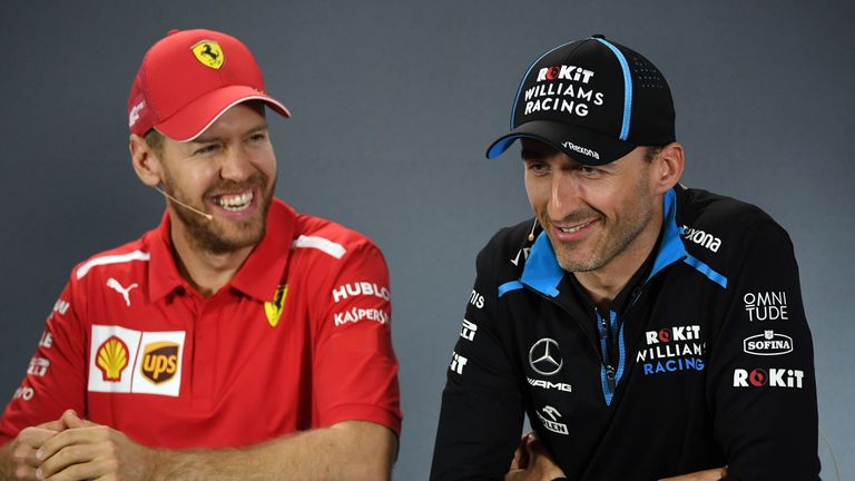 Robert Kubica is back on the grid. And Sebastian Vettel looks happy about it!