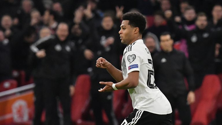 Germany's forward Serge Gnabry celebrates after scoring their second goal during the UEFA Euro 2020 Group C qualification football match between Netherlands and Germany at the Johan Cruyff Arena in Amsterdam on March 24, 2019