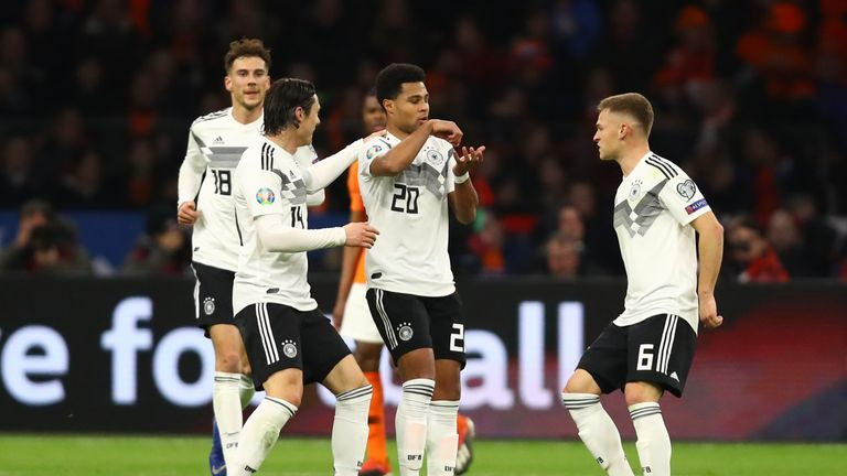 Serge Gnabry of Germany (20) celebrates after scoring his team's second goal with team mates during the 2020 UEFA European Championships Group C qualifying match between Netherlands and Germany at Johan Cruyff Arena on March 24, 2019 in Amsterdam, Netherlands