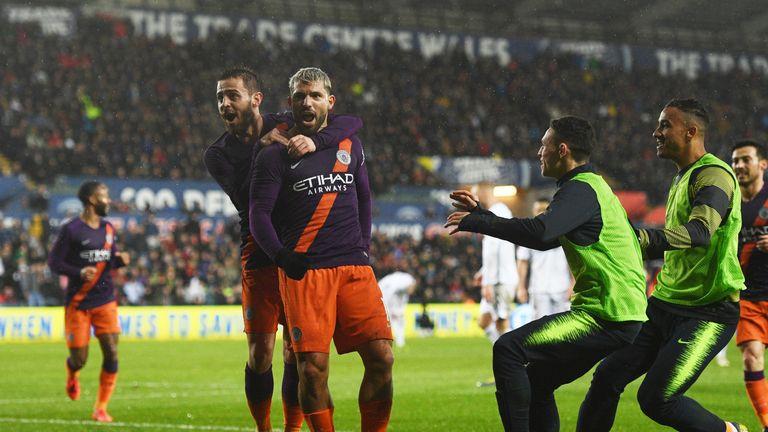 Sergio Aguero celebrates with Bernardo Silva after scoring Manchester City's winner against Swansea