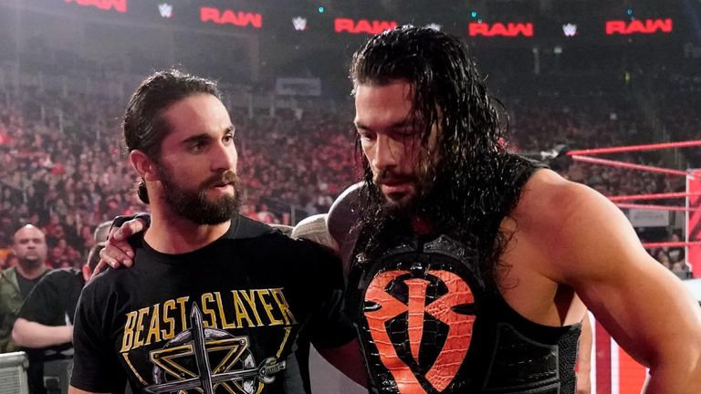 Seth Rollins helped Roman Reigns from ringside after he was assaulted by Drew McIntyre