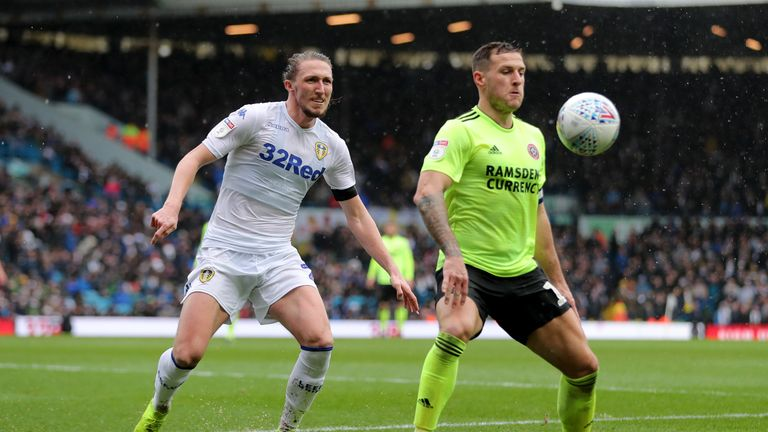 Sheffield United's Billy Sharp and Leeds' Luke Ayling battle for the ball