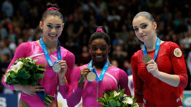 A 16-year-old Biles celebrates World Championship gold in 2013