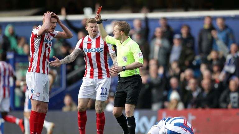Stoke City's Sam Clucas receives a red card from match referee Gavin Ward