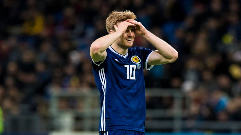 Stuart Armstrong holds his head in his hands as Scotland were humiliated in Kazakhstan