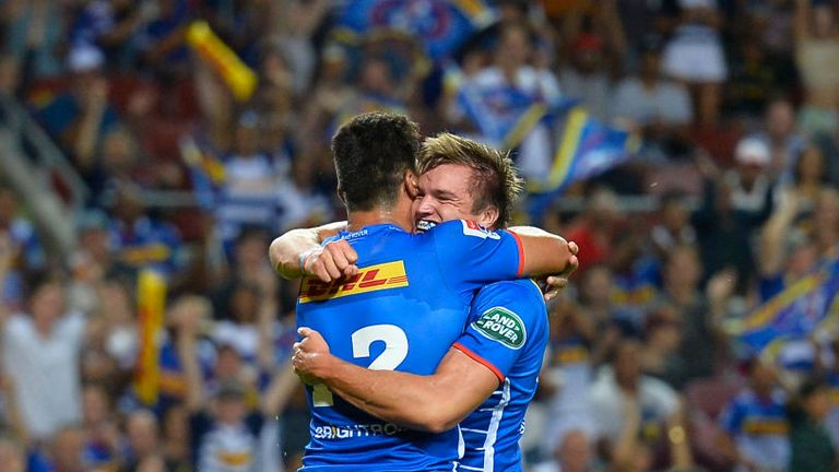 Dan du Plessis celebrating mid-match after scoring a try