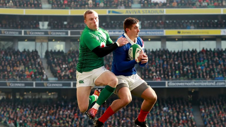 Thomas Ramos and Keith Earls compete for the ball in the air