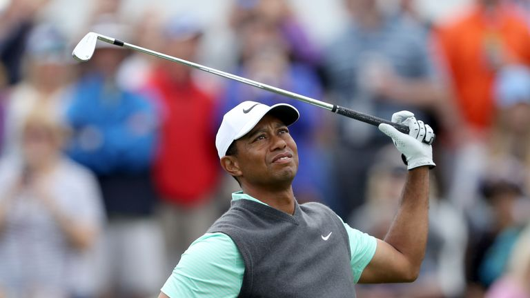 Tiger Woods slipped down the leaderboard after a poor front nine