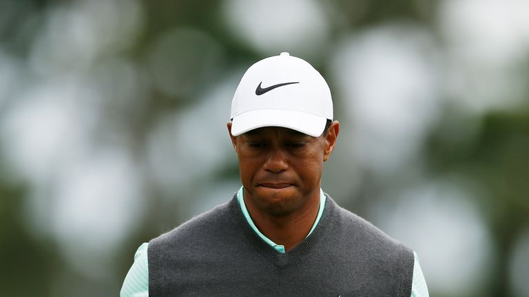 Woods battled back to salvage a 72