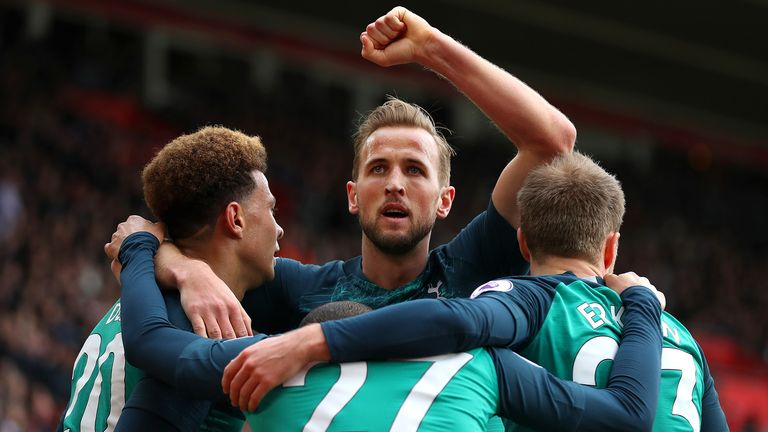 Harry Kane of Tottenham Hotspur celebrates with teammates after scoring his team's first goal during the Premier League match between Southampton FC and Tottenham Hotspur at St Mary's Stadium on March 09, 2019 in Southampton, United Kingdom.