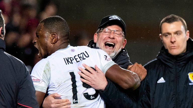 Hearts' Uche Ikpeazu celebrates with manager Craig Levein