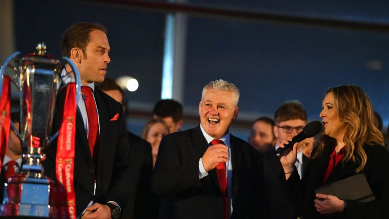 Sports journalist Catrin Heledd (right) with Wales captain Alun Wyn Jones (left) and head coach Warren Gatland during the 2019 Guinness Six Nations Grand Slam winners celebration welcome at the Senedd in Cardiff Bay, 18 March 2019