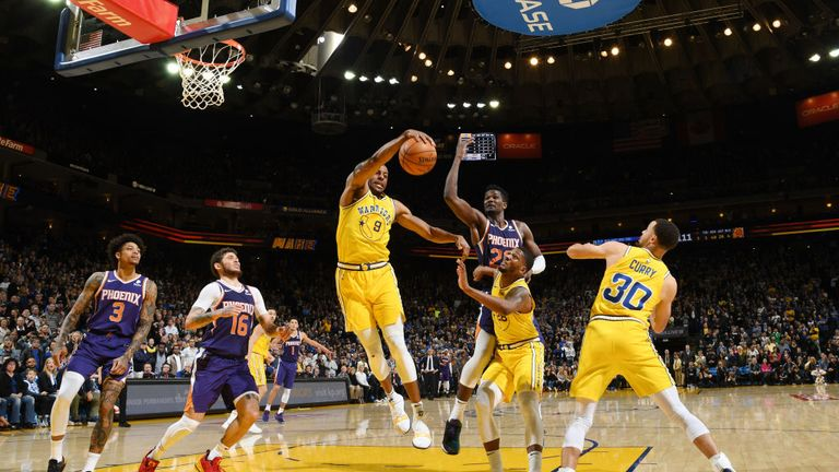Andre Iguodala of the Golden State Warriors rebounds the ball against the Phoenix Suns