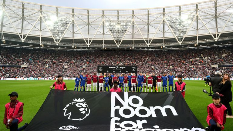 West Ham and Everton players stand with match officials in support of the Premier League's 'No Room For Racism' campaign