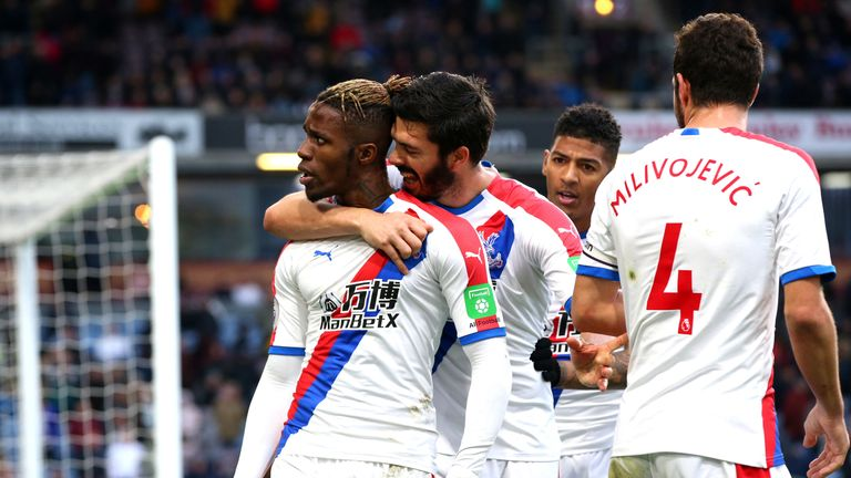 Wilfried Zaha of Crystal Palace celebrates after scoring his team's third goal