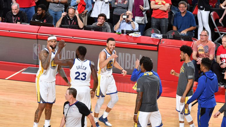 Stephen Curry celebrates victory over the Houston Rockets with his Golden State team-mates