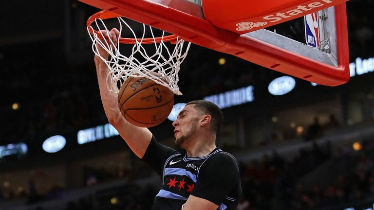 Zach LaVine hammers home a dunk against the 76ers