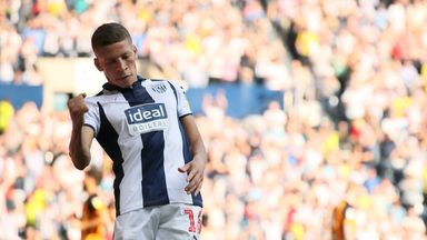 Dwight Gayle celebrates after making it 3-2 to West Bromwich Albion
