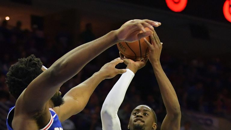 Caris LaVert shoots over Joel Embiid