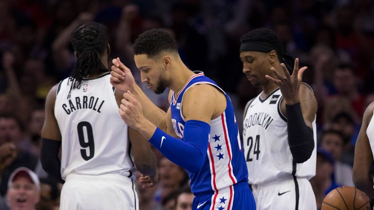 Ben Simmons celebrates in front of frustrated Nets players