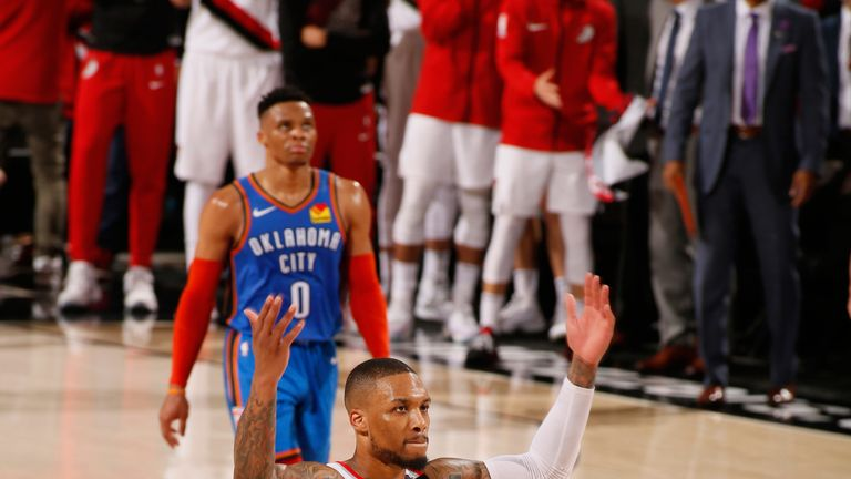 Damian Lillard salutes the Moda Center crowd during Portland's Game 2 win over Oklahoma City