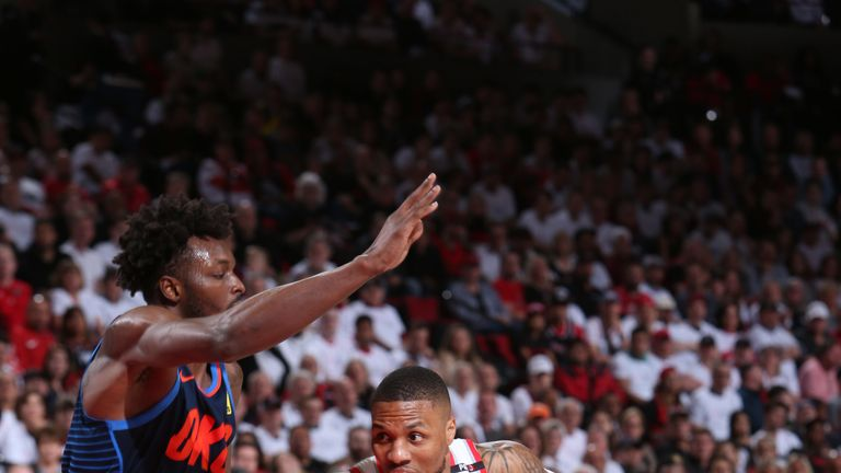 Portland's Damian Lillard blows by Thunder forward Serge Ibaka during Game 5