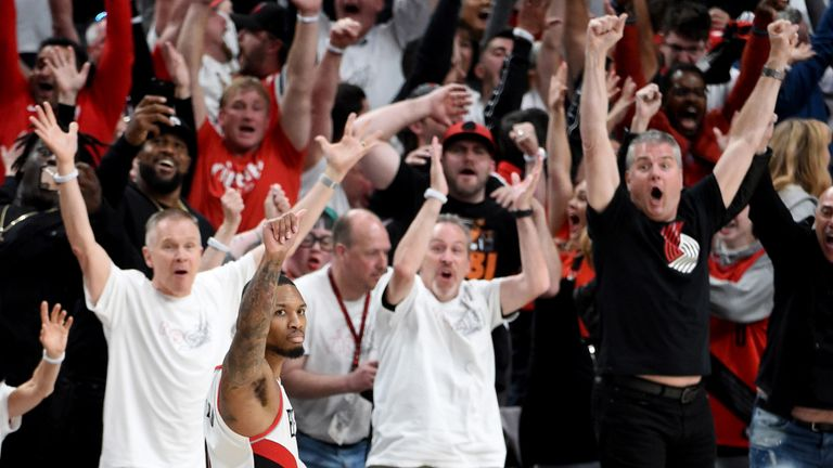 Damian Lillard celebrates after his buzzer-beating three-pointer sealed a 4-1 series win for Portland
