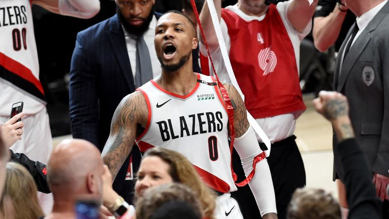 Damian Lillard roars to the Portland fans after his buzzer-beater earned Portland a 4-1 series win over the Thunder