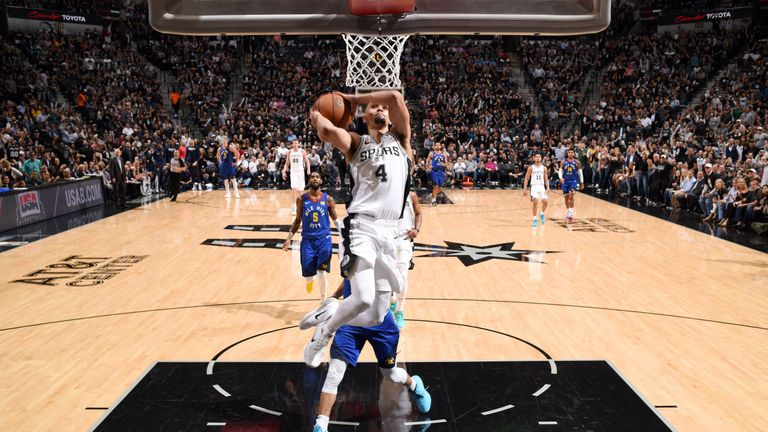 Derrick White scores with a dunk during the Spurs' Game 3 win over the Nuggets