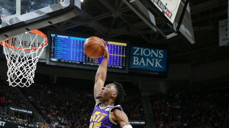 Donovan Mitchell soars for a dunk against Charlotte