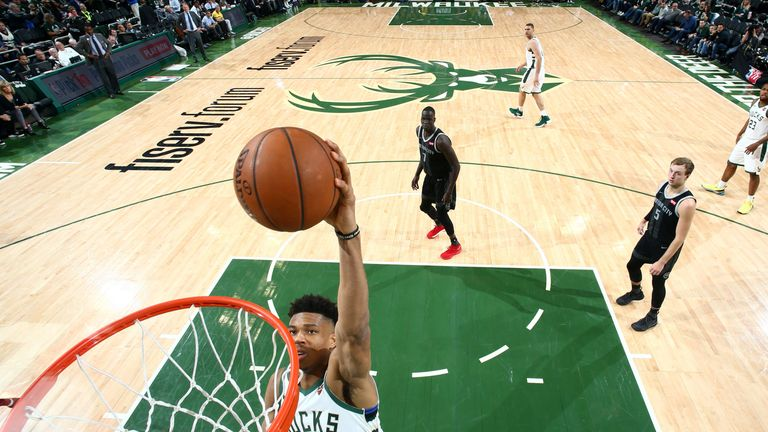 Giannis Antetokounmpo rams home a dunk in the Bucks' Game 2 win over the Pistons