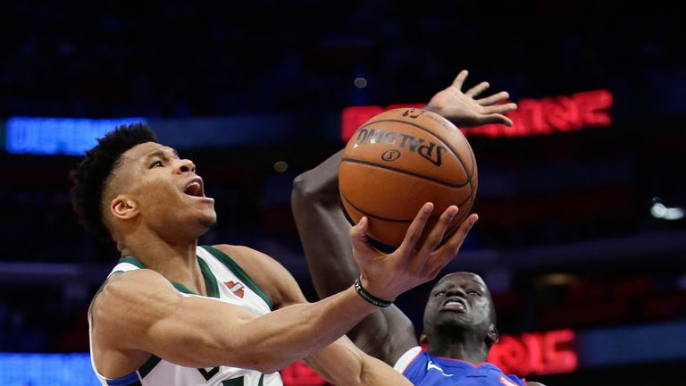Giannis Antetokounmpo lofts a scoop lay-up against Detroit