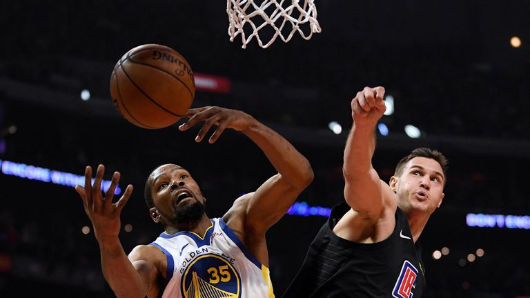 Kevin Durant contests a rebound with Danilo Gallinari