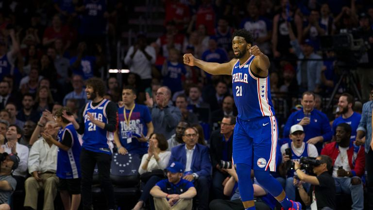 Joel Embiid celebrates the Sixers' first-round series win over the Nets
