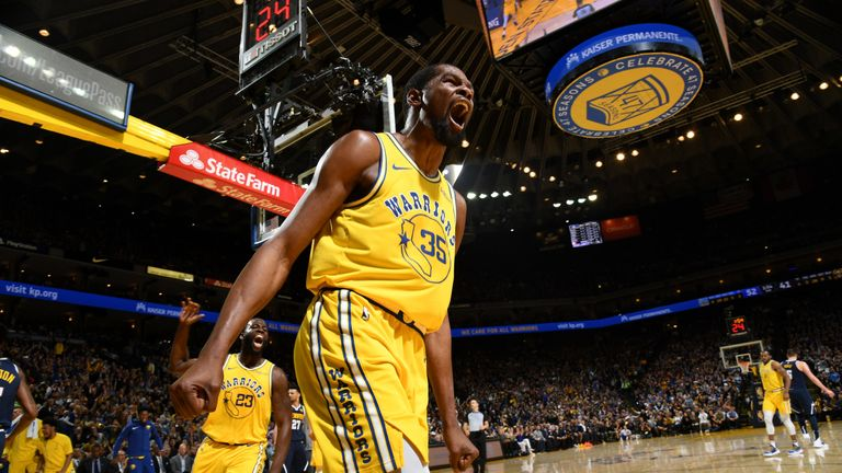 Kevin Durant celebrates after slamming home a coast-to-coast dunk against the Denver Nuggets