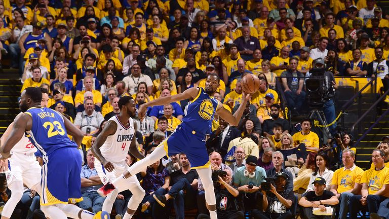 Kevin Durant stretches before firing a pass in Golden State's Game 5 loss to the Clippers