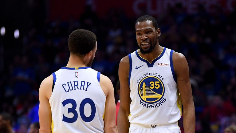 Stephen Curry congratulates Kevin Durant during the Golden State Warriors' Game 3 win over the Los Angeles Clippers