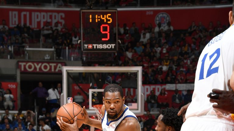 Kevin Durant takes on Patrick Beverley in the Warriors' Game 6 win over the Clippers