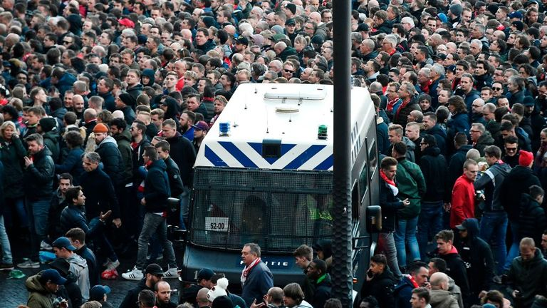 Amsterdam police fire water cannon at fans ahead of Ajax vs