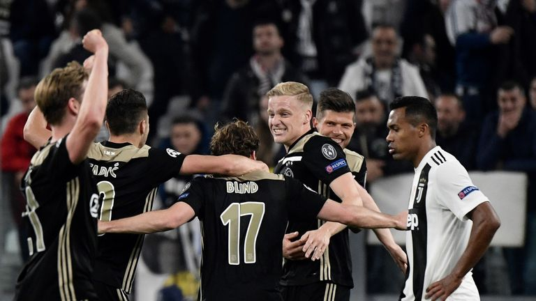 Ajax celebrate their victory in Turin to reach the Champions League last four